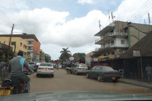 Kampala city scene with boda and car traffic